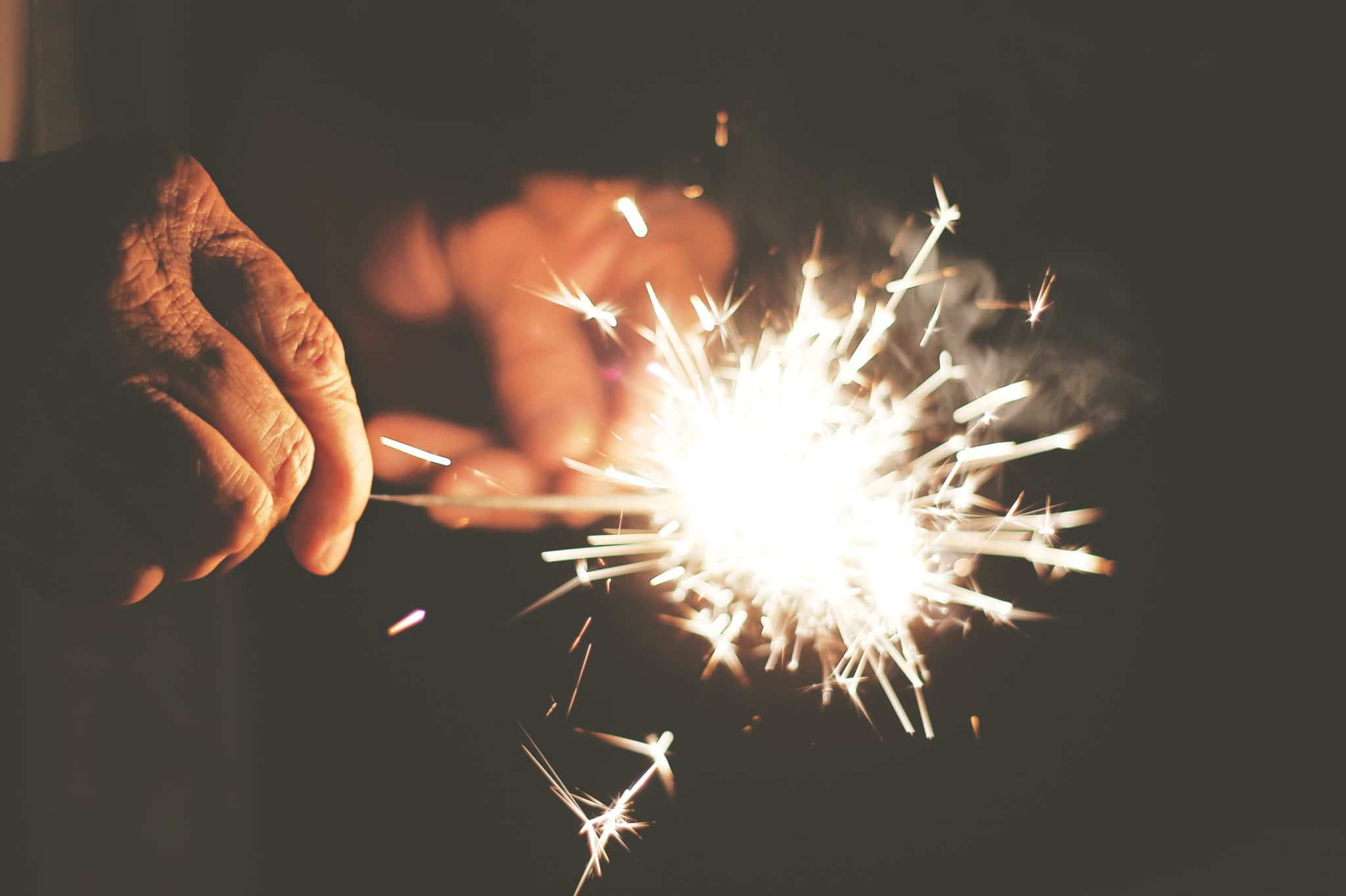 man close up of hands with sparkler