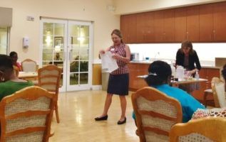 Nurse Mary reviewing information for the Responsive team