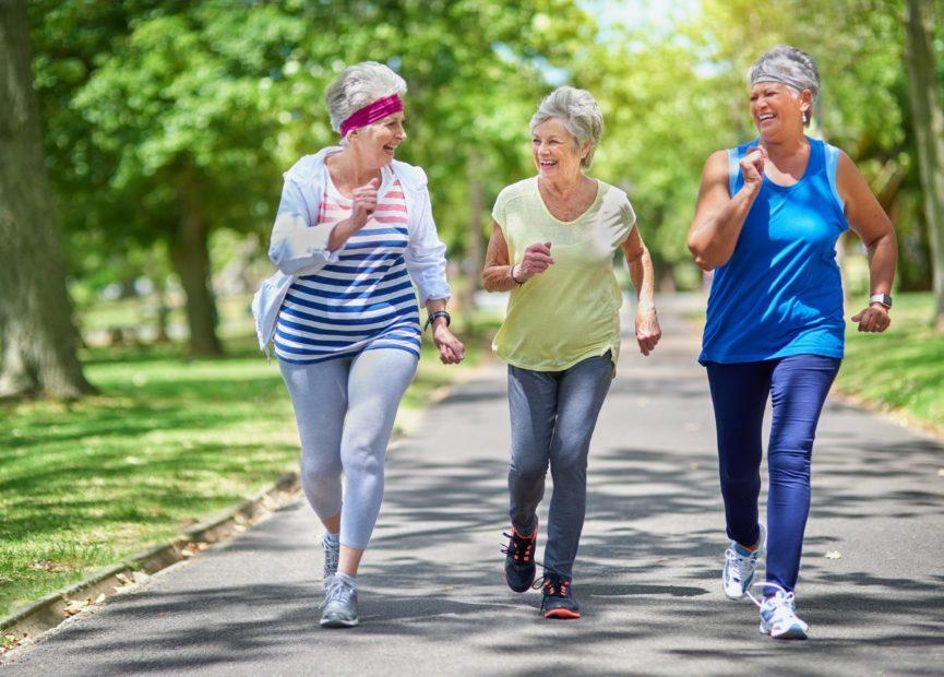 three senior woman outside walking as exercise