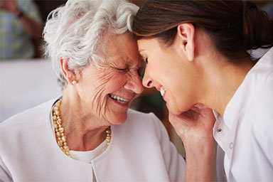 Client and caregiver smiling
