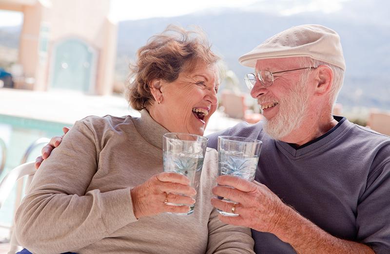 happy senior couple outside