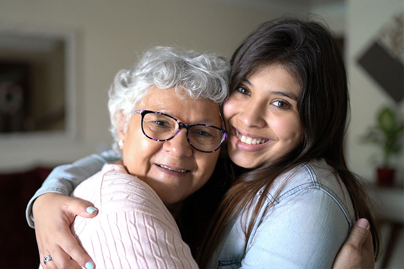 progression of dementia in senior hugging caregiver